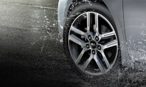 2021 Kia Forte close up on wheel in rain silver paint