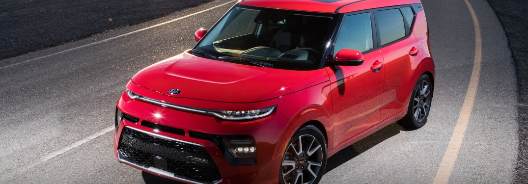 2021 Kia Soul red driving around corner close shot