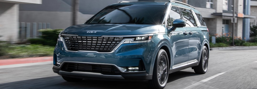 2022 Kia Carnival MPV blue coming down street