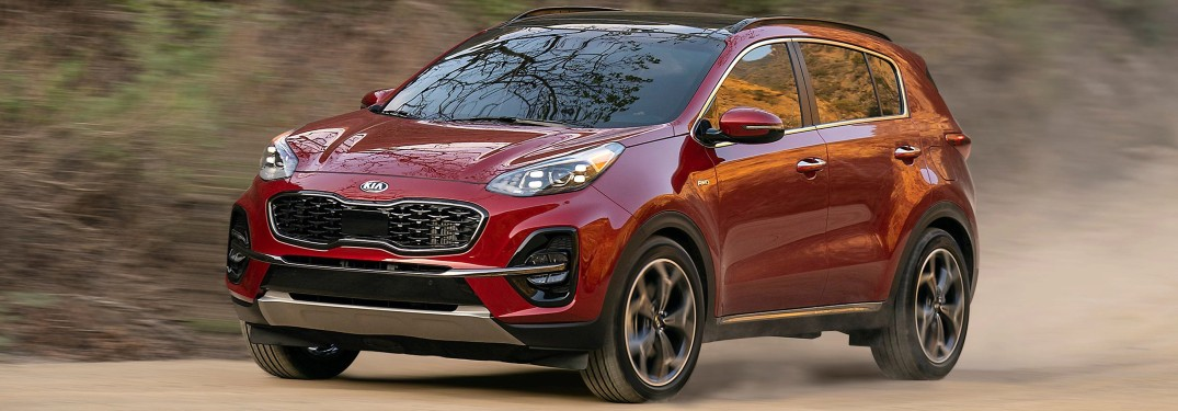 2022 Kia Sportage red driving on dusty road