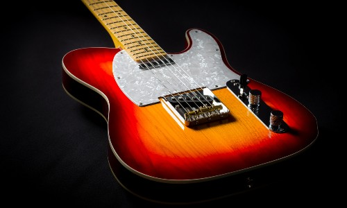 sunburst telecaster guitar on black background
