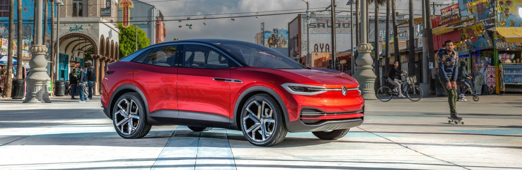 Volkswagen I.D. CROZZ in Red with city background