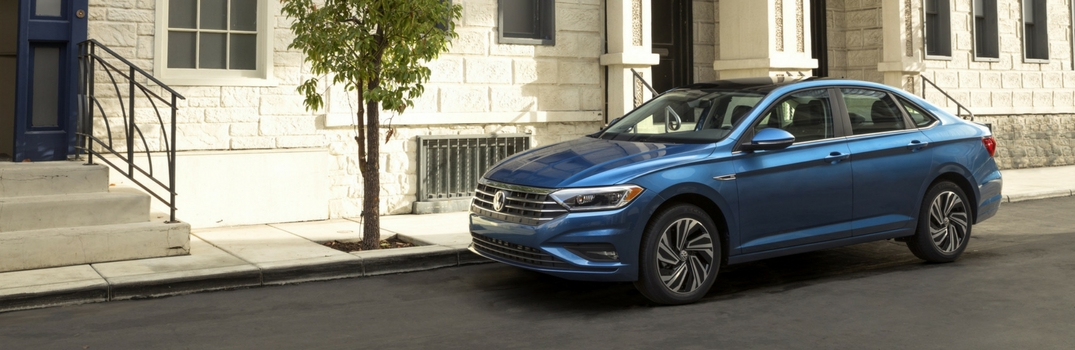 2019 VW Jetta in front of city apartment building