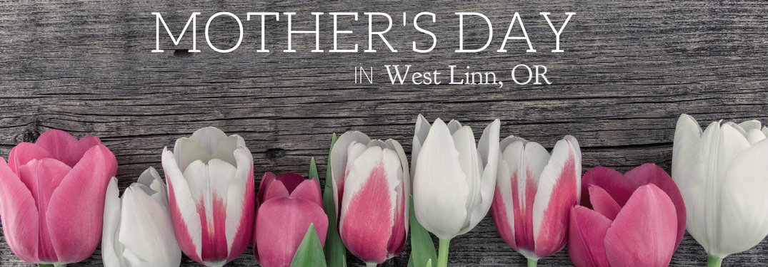 Mother's Day in West Linn OR written on wood plaque with daffodils in front