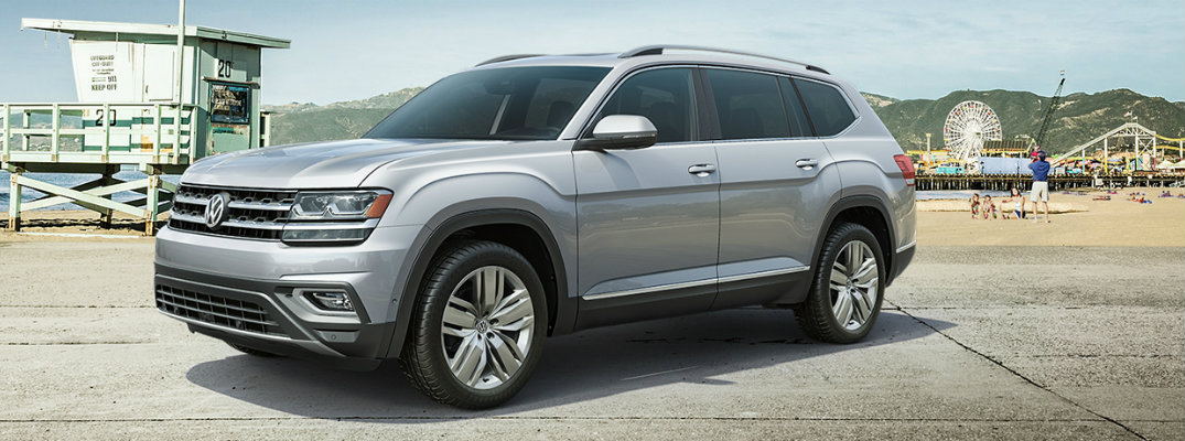 Profile view of silver 2019 Volkswagen Atlas parked on pier