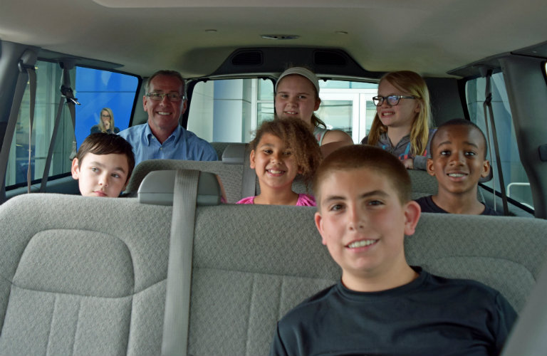 kids in van donated by Baierl Automotive