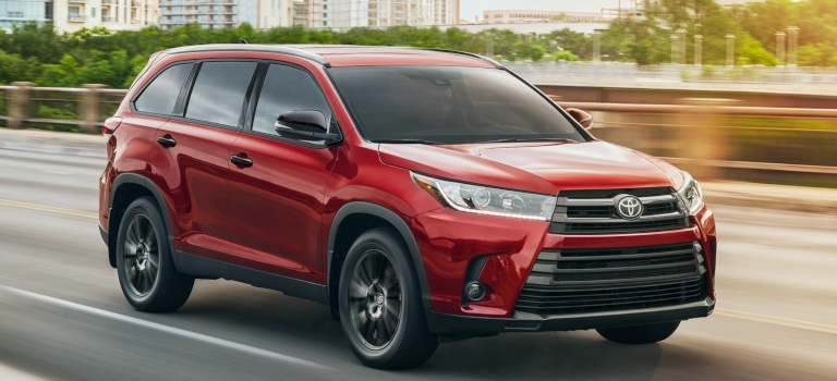 2019 Toyota Highlander on the road red side view