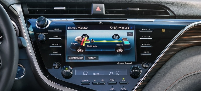 2019 Toyota Camry infotainment screen displaying hybrid information