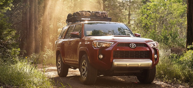 2019 Toyota 4Runner red front view on dirt trail