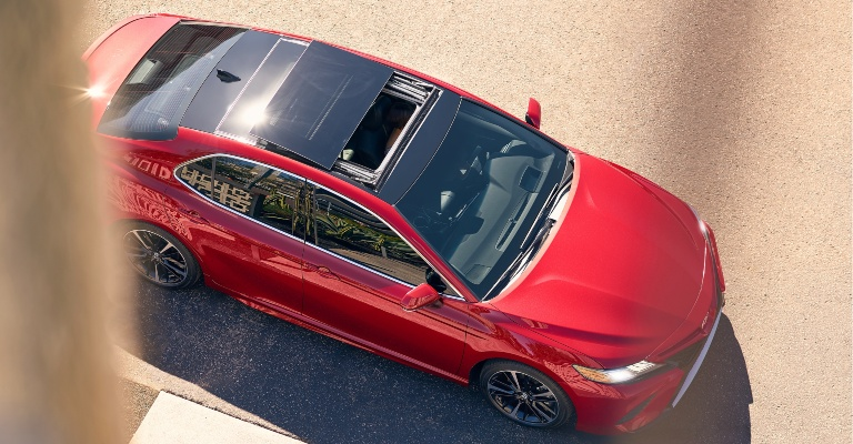 2019 Toyota Camry red top view with a panoramic glass roof