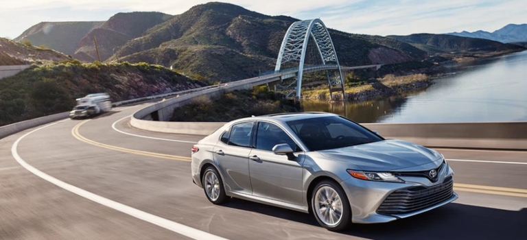 2019 Toyota Camry silver side view with a moonroof
