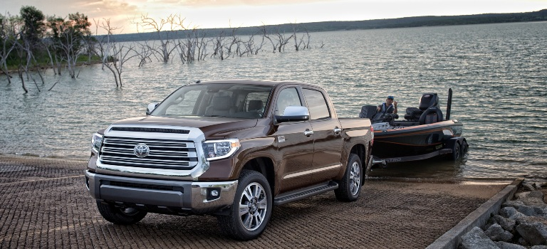 2020 Toyota Tundra brown front view towing a boat
