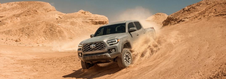 2020 Toyota Tacoma gray going down sand