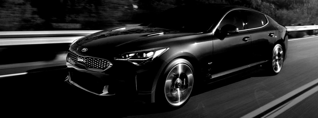 Black and white image of 2018 Kia Stinger cruising on a highway