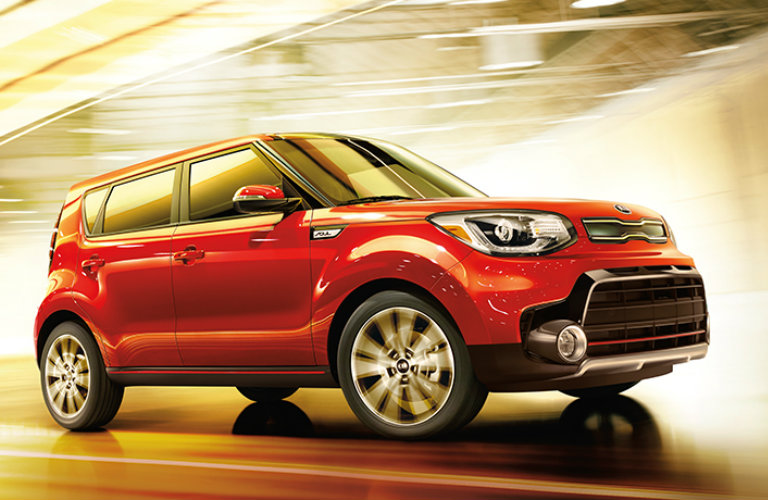 Front/side profile of red 2018 Kia Soul