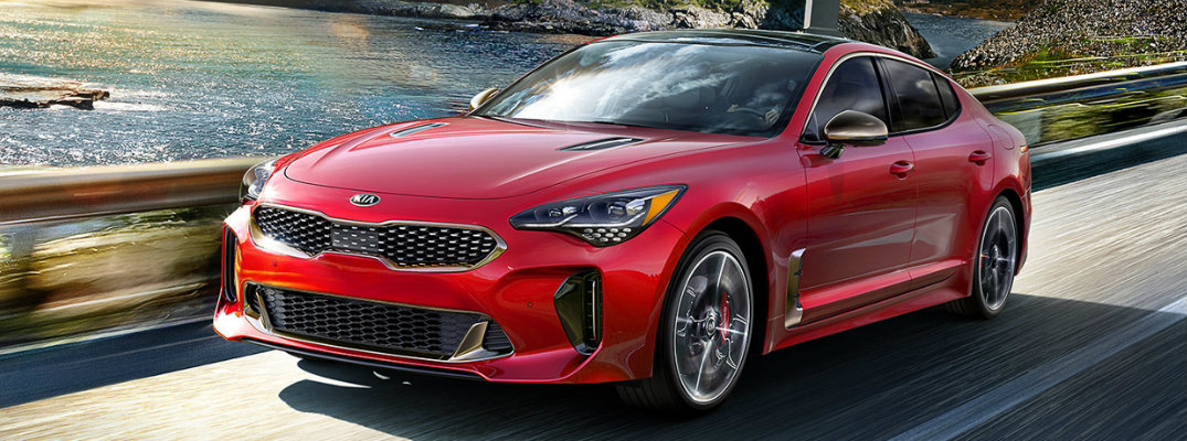 Red 2019 Kia Stinger going over a bridge
