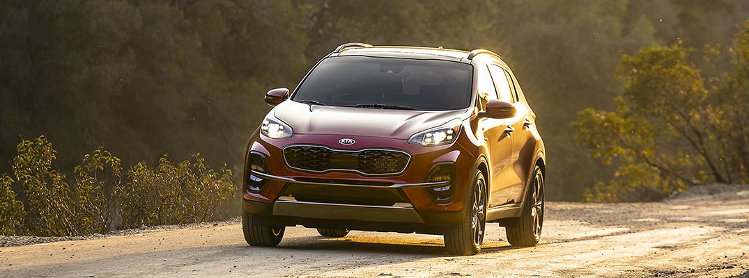 2020 Kia Sportage driving during the golden hour
