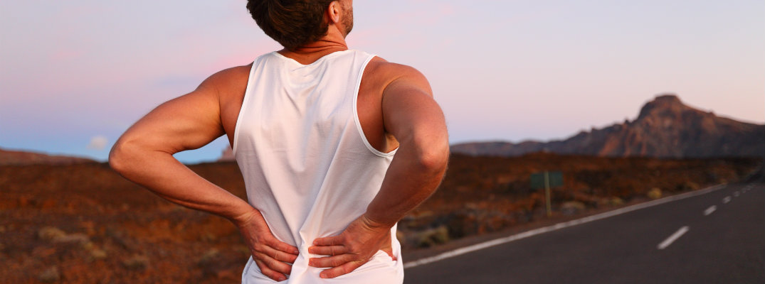 Man with back pain while on the road