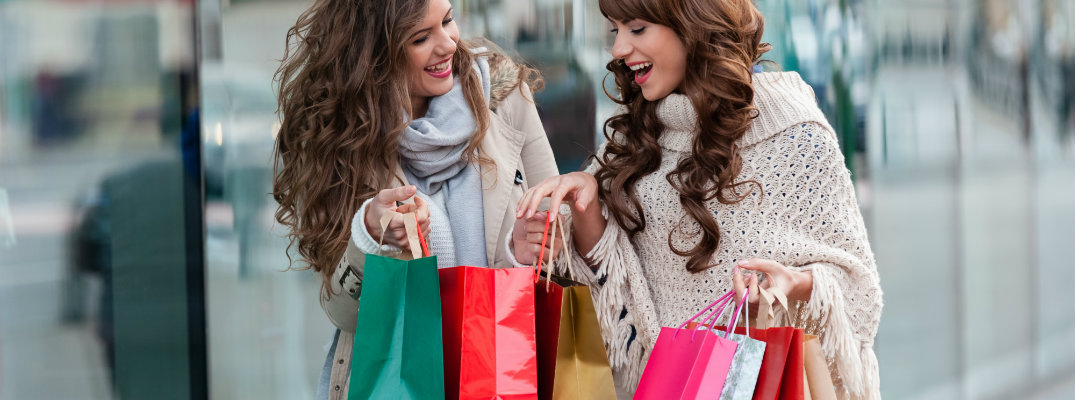 Two women shopping during the year-end holiday season