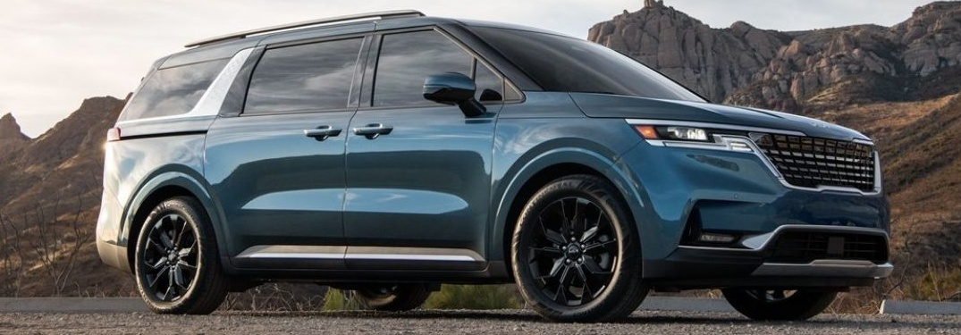 2021 Kia Carnival with hill in the background
