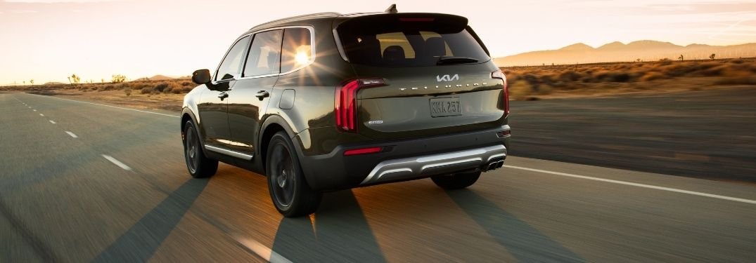 2022 Kia Telluride travelling on road with a beautiful beam of sunlight reflected on it