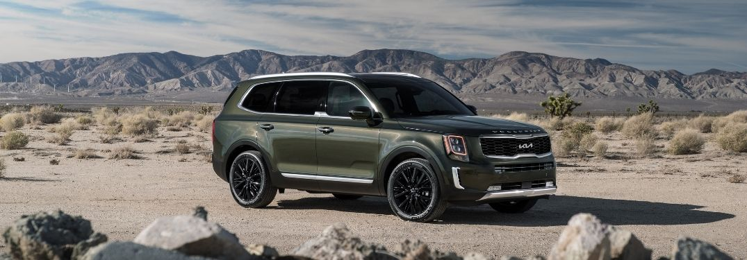 2022 Kia 5elluride parked in the middle of rocks in a rugged place
