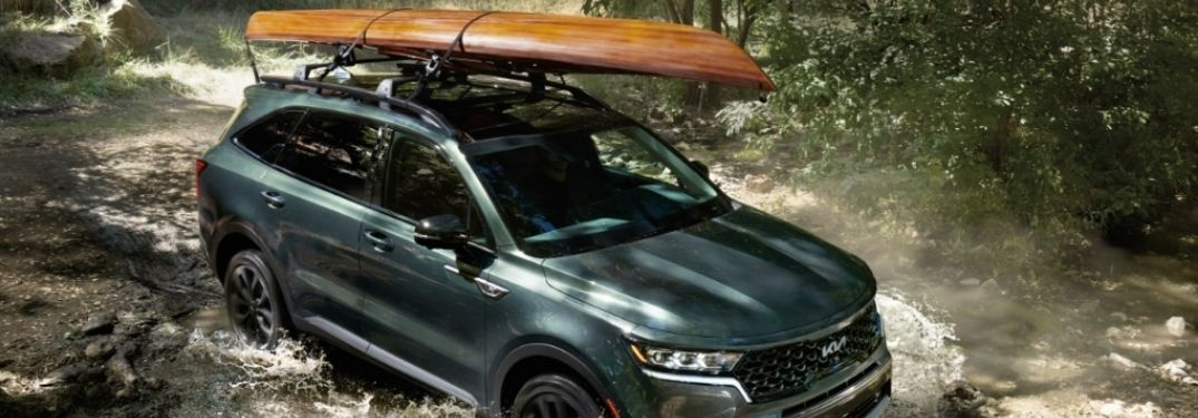 2022 Kia Sorento carrying load on top and driving through water