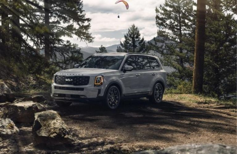 Side-view of the 2022 Kia Telluride Parked in a Forest