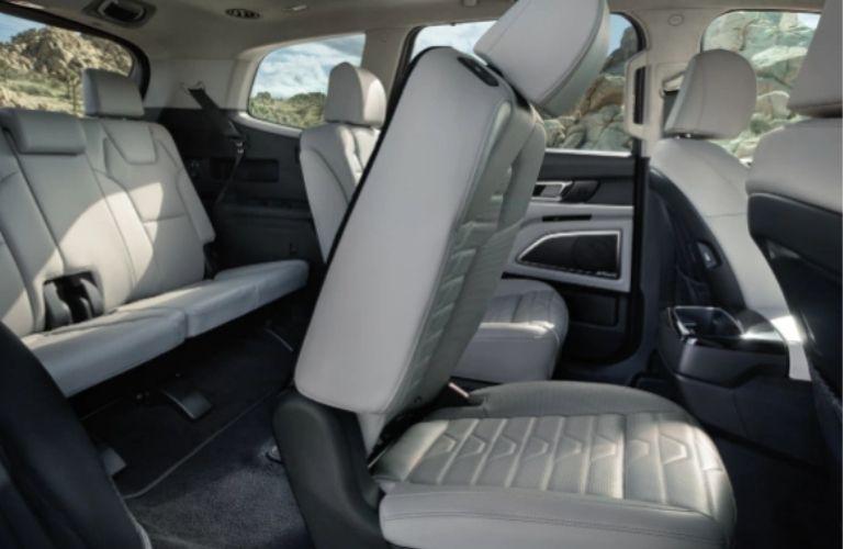 2022 Kia Telluride Interior where the second row captain's chair is half-folded