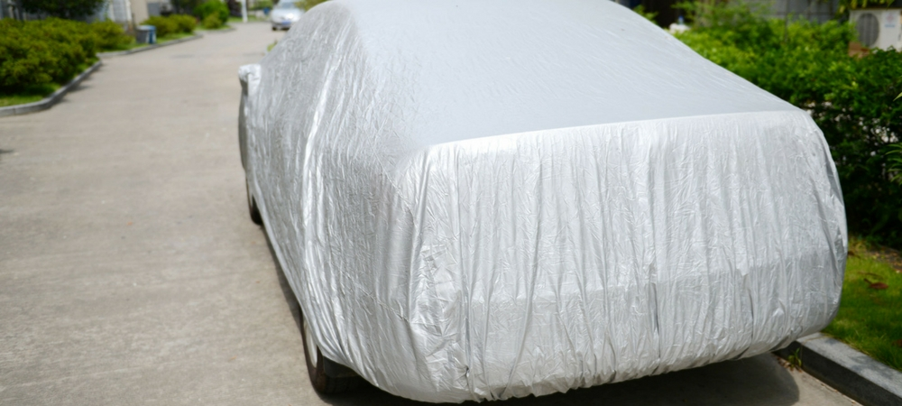 A picture of a car covered with a car cover in a blog post about car gifts
