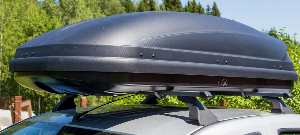 A roof box on top of a car in a blog post about car gifts