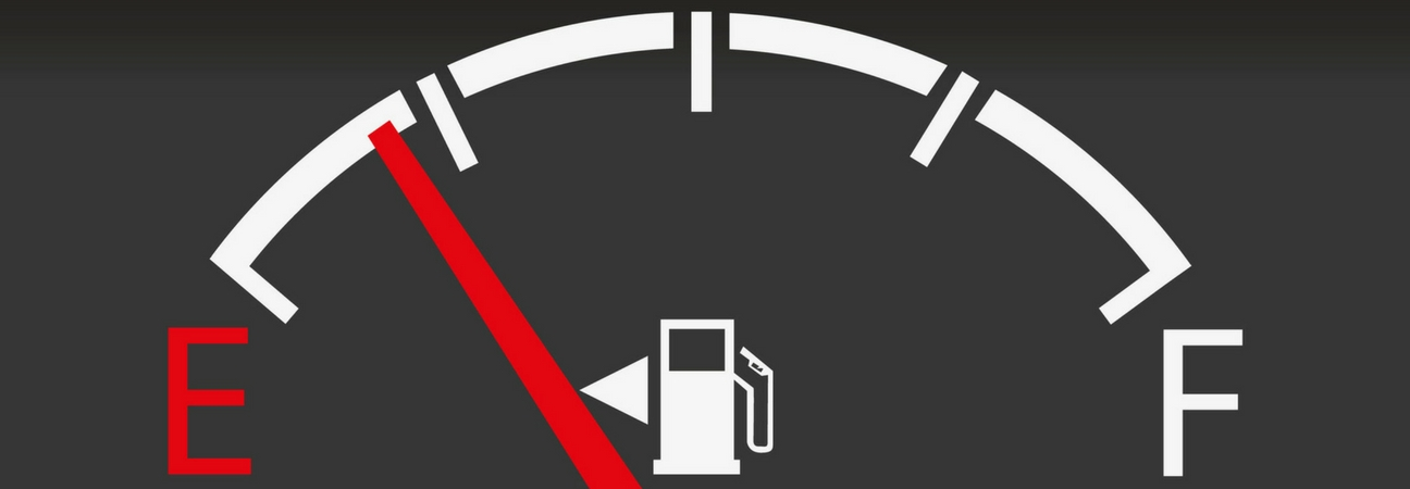 A close up of a gas gauge featured in a blog post about gas mileage