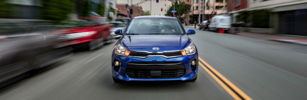 2018 Kia Rio Deep Sea Blue paint color and driving downtown