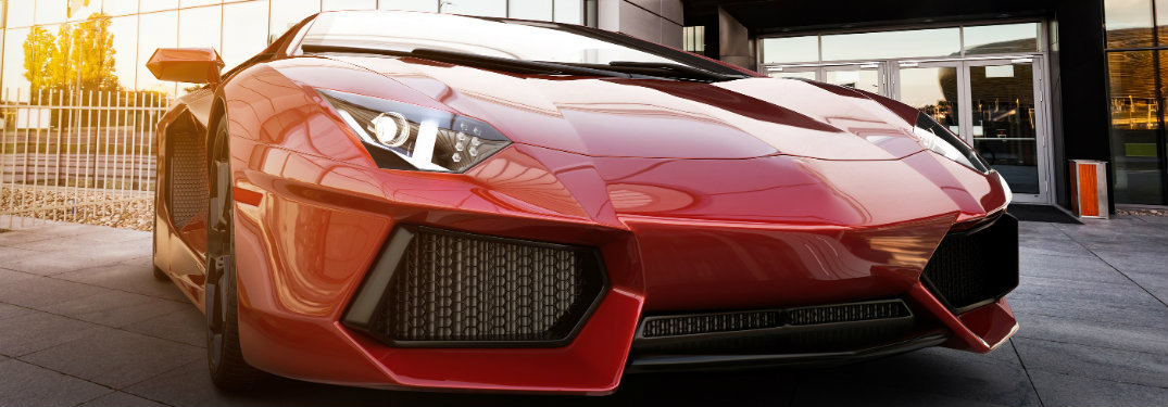red-exotic-sports-car-parked-outside-building