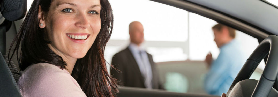 Woman behind the wheel of car