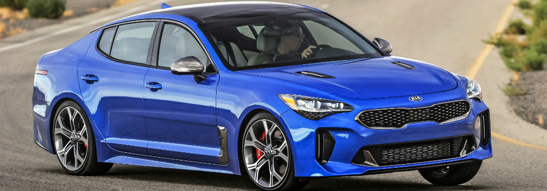 2018 Kia Stinger blue side view cornering hard