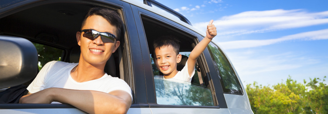 dad driving son in a car