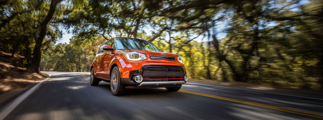 2019 Kia Soul driving through a forest