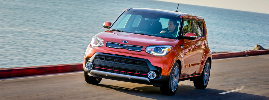 2019 Kia Soul driving by the ocean
