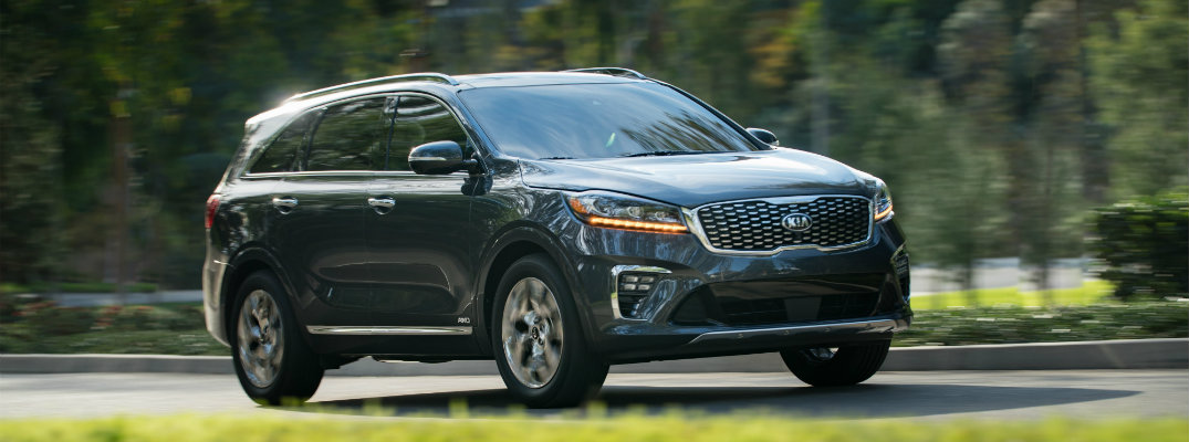 2019 Kia Sorento driving through a neighborhood