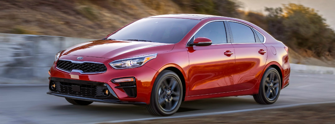 2019 Kia Forte driving at dusk