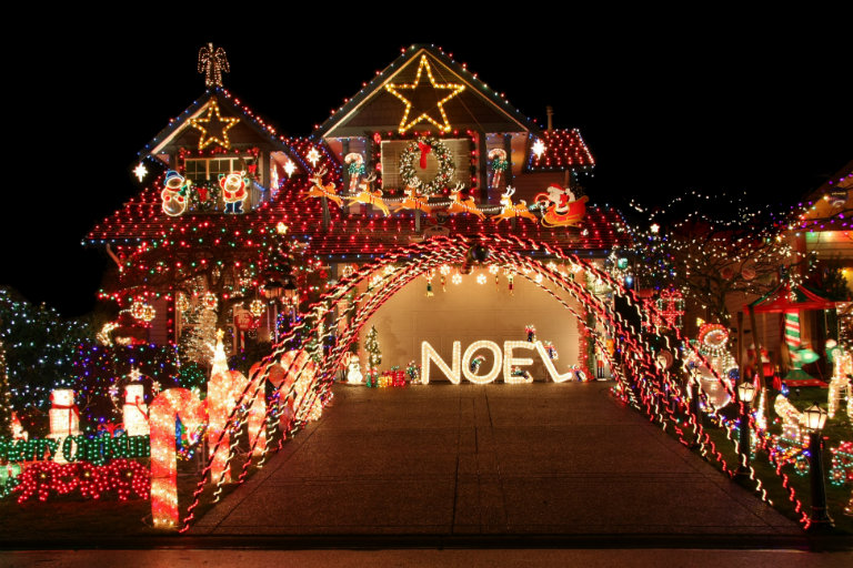 A house at night with Christmas lights