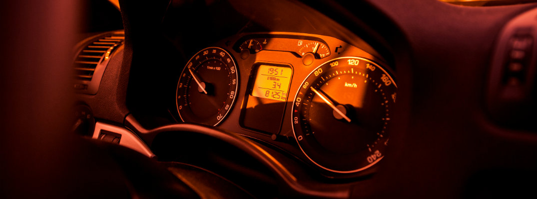 Red-toned image of a car's dashboard