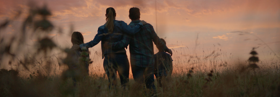 "family in the Ram ""Thanksgiving Grace"" commercial as the sun sets"