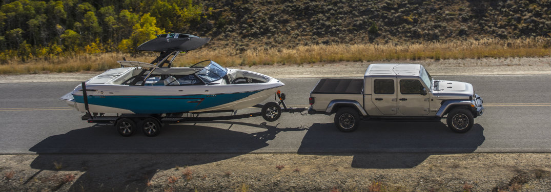 2020 Jeep Gladiator truck towing a boat