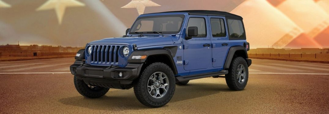 2020 Jeep Wrangler Freedom edition on pavement with American flag graphic in back