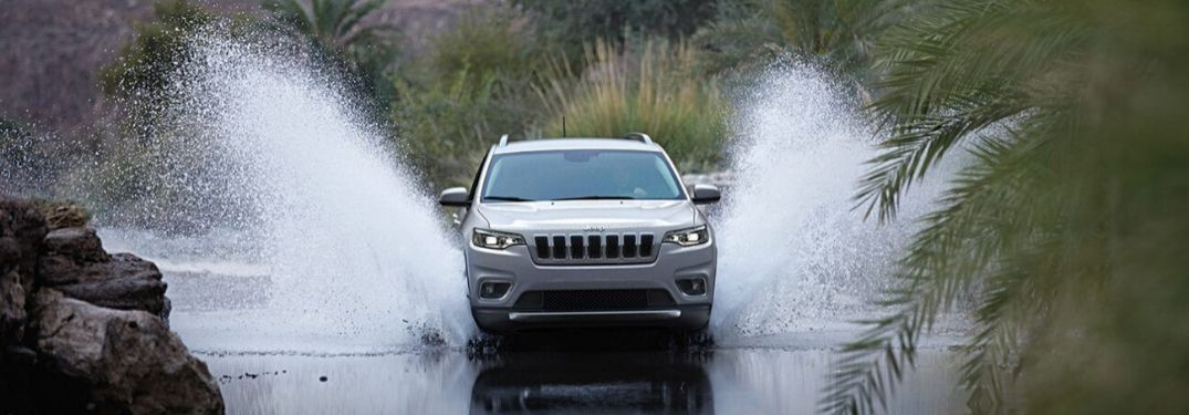 2020 Jeep Cherokee splashing through water
