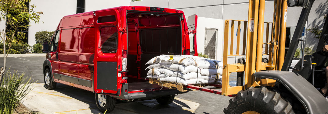 red 2018 Ram ProMaster cargo van being loaded with supplies