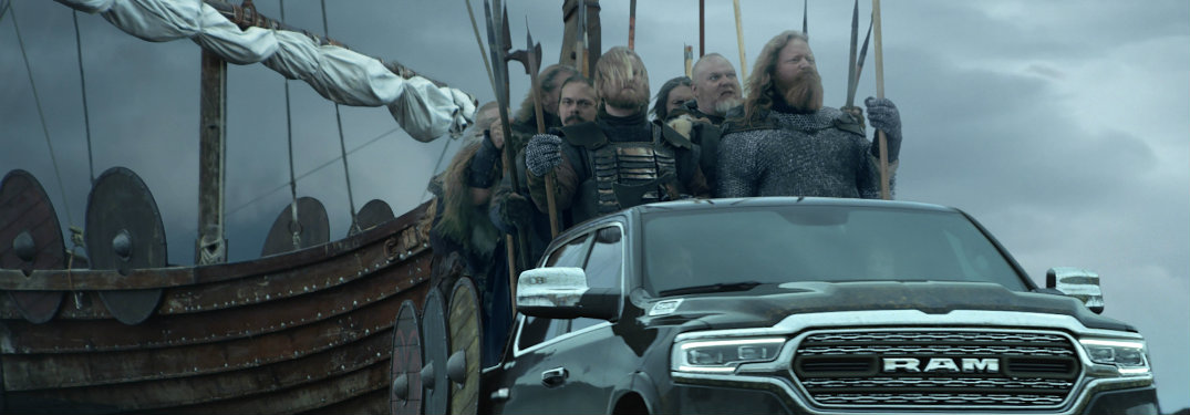 Icelandic Vikings riding a Ram truck with their ship in the background in Ram Super Bowl 52 commercial