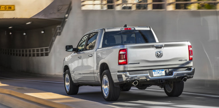 2019 Ram 1500 driving on a highway through the city